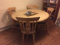 Round pine table and four pine chairs