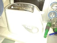 Good quality white Asda toaster with several functions. Works well. Looks good. Bargain