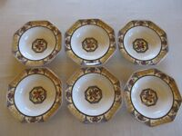 Set of 6 dessert bowls and 10 inch serving bowl by Wedgwood and Co.