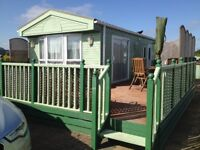 Two bedroom static in mint condition sited on much sought after corner plot extended decking