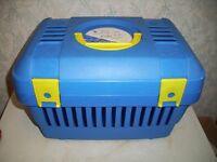 Blue plastic pet carrier