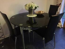 Black glass extending table + 3 high backed chairs
