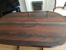 High gloss dark wood oval dining table & 6 chairs