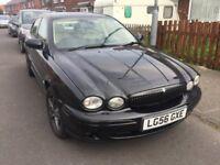 Black 'X' type jaguar with leather interior