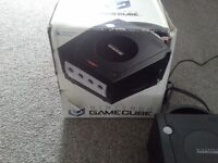 Boxed black nintendo gamecube with 5 games