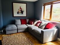 Creations grey corner sofa with grey and raspberry scatter cushions and footstool