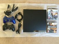 Playstion 3, 2 controllers, 2 games and hdmi cable