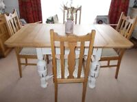 Oak draw-leaf table with four oak chairs. Dining / kitchen.