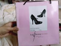 New woman high heel shoes by Ellie