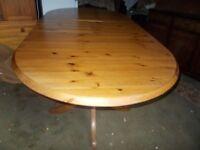 A DUCAL PINE EXTENDING TABLE