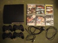 Sony PlayStation 3 With 4 controllers and 6 games