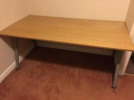 Big office table on metal legs