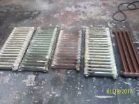 FOUR CAST IRON RADIATORS ONE NEW THE SMALL ONE