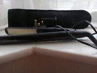 Remington Hair straighteners with pouch.