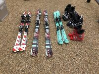 3 pairs children's skis with boots.