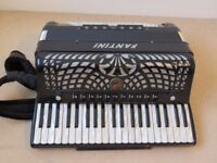 Piano Accordion. Fantini Professional 41/120 in plain black with mother of pearl key.s in hard case.