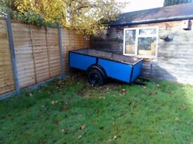 Blue open wooden 8 x 4 ft braked trailer