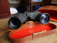 Old pair of Zoom Binoculars; Octra 7x-12x 40 Field 5.5 at 12x, used, in original leather field case.