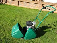 Suffolk Punch Lawn mower with scarifier