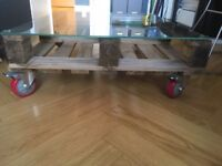 upcycled pallet coffee table on wheels with glass top