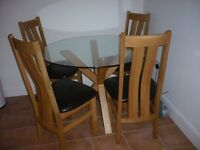 Very sturdy circular topped, oak legs and matching chairs x 4