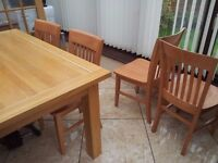 solid oak dinning table and 4 chairs
