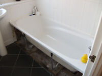 White bath with chrome mixer taps and pop up waste'