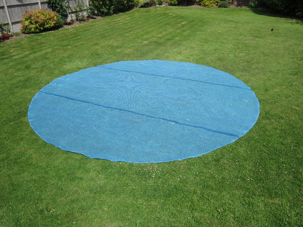 """Solar Cover to suit 156"""" Diameter Swimming Poolin Hayling Island, HampshireGumtree - I have for sale a Blue 600 Micron Solar Cover to suit 156"""" Diameter Pool or smaller (can be cut to size with scissors). It has been used for one season only, so is in very good condition. Normal price is £75.00 plus. It has two slits to fit around..."""
