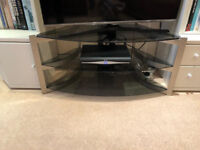 Glass tv stand only 6 months old selling as moving £25 not a mark on it