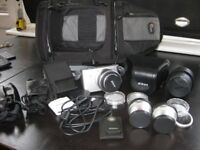 Nikon J1 Silver Camera with loads of extras