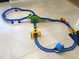Dinosaur train set with battery operated red train