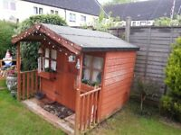 Wooden playhouse for garden