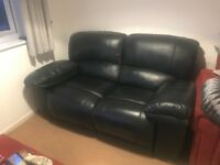 Two seater real leather manual reclining sofa and faux leather storage footstool