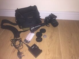 Canon EOS 110D with zoom lens. Comes with all accessories