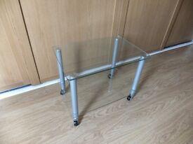 Glass wheeled TV table