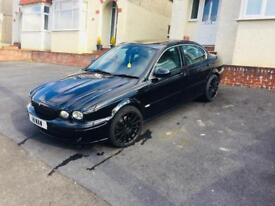54 plate Black Jaguar X Type 2.0 litre diesel