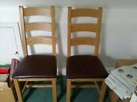 Two Solid oak and leather seated dining chairs