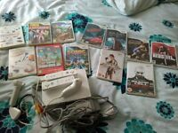 wii console and 12 games