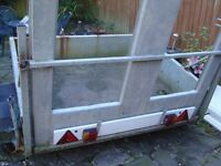 HEAVY DUTY STEEL TRAILER 62INCH WIDE 52INCH LONG WITH LOADING RAMP AND LIGHTING BOURD