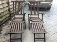 A very nice pair of teak sun loungers
