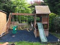 Wooden climbing frame with 2 swings and slide