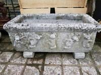 Concrete trough planter.