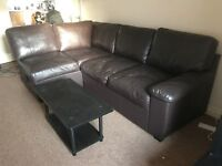 MUST GO URGENT: Brown leather Sofa bed with storage and coffee table to match. Drop off possible