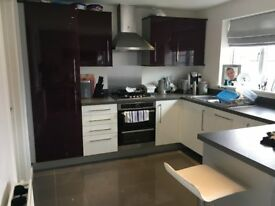 Jewson Galaxy high Gloss kitchen and utility with double oven gas hob and stainless extractor