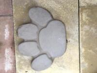 Concrete dog paw patio flags