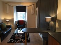 QUIET CLEAN TOP FLOOR 1 BEDROOM FURNISHED FLAT FREE PARKING AND FAST FREE WIFI