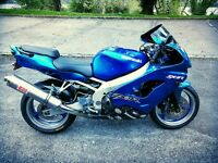 Kawasaki zx9r candy blue, looking to get nice car? Convertible? Upright bike?