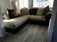 Large fabric and leather corner sofa