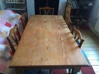 Solid pine dining table with drawers and 6 cushioned chairs
