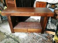 Low, long dark wood tv stand style.